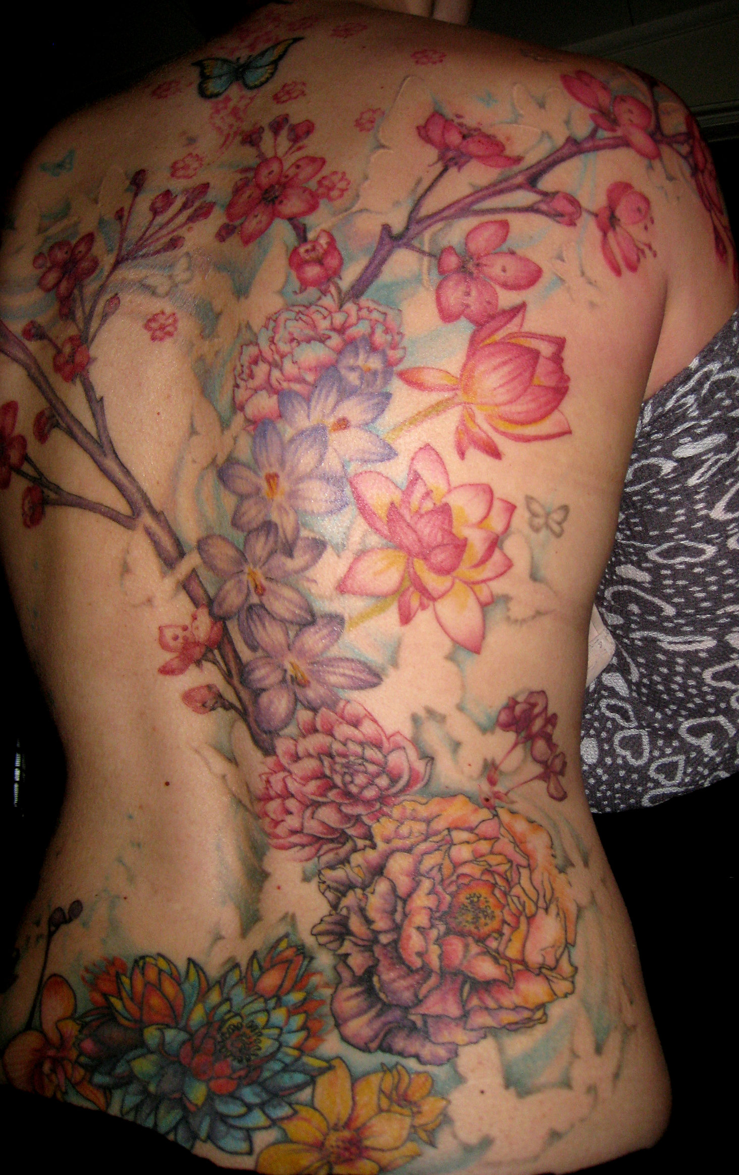 lookingglassnj | Floral Back tattoo by Amber Opal