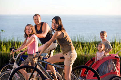 hispanic family on bikes