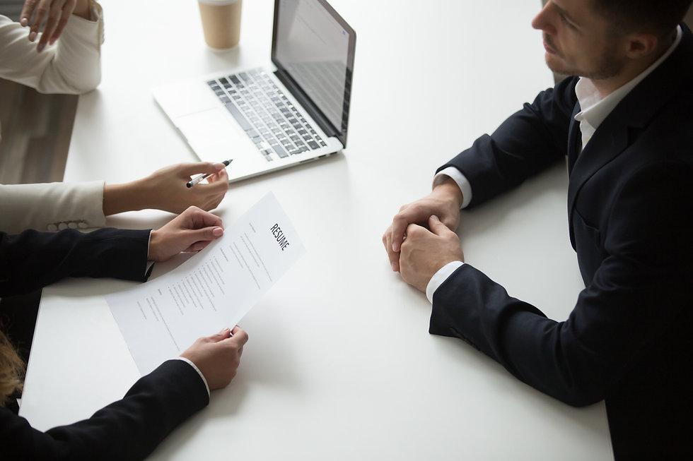 male-applicant-having-job-interview.jpg