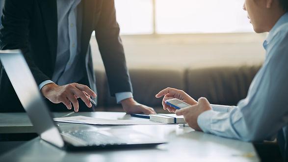 two-businessman-analyzing-company-financ
