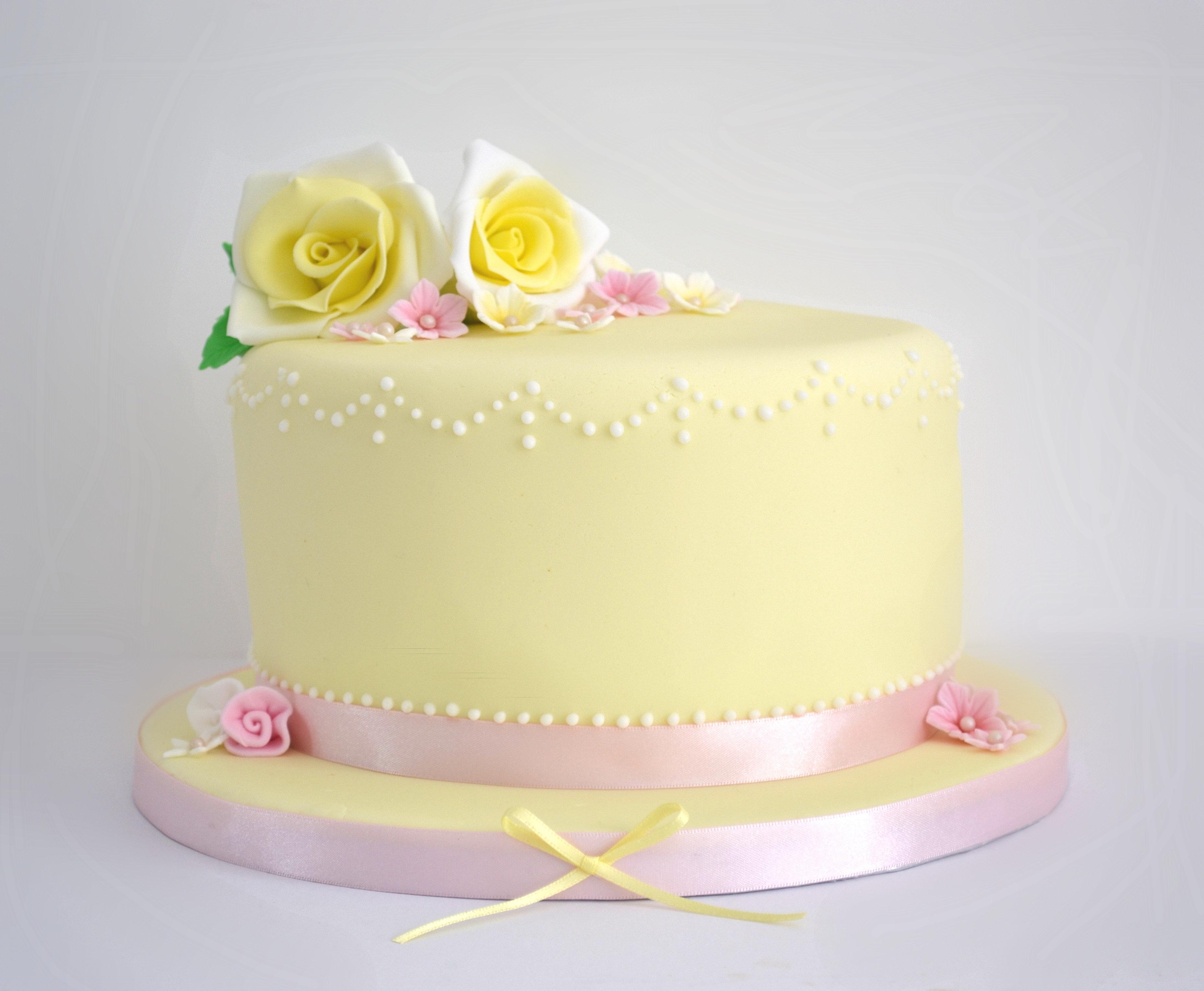 Pastel yellow birthday cake