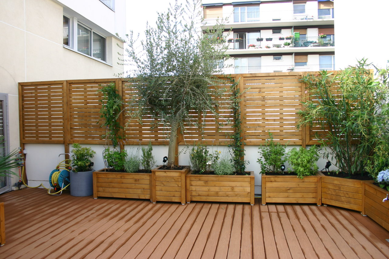 Cl ture jardin bois solide occultation clotures bois for Photos terrasse en bois