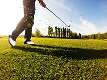 golfer-performs-a-golf-shot-from-the-fai