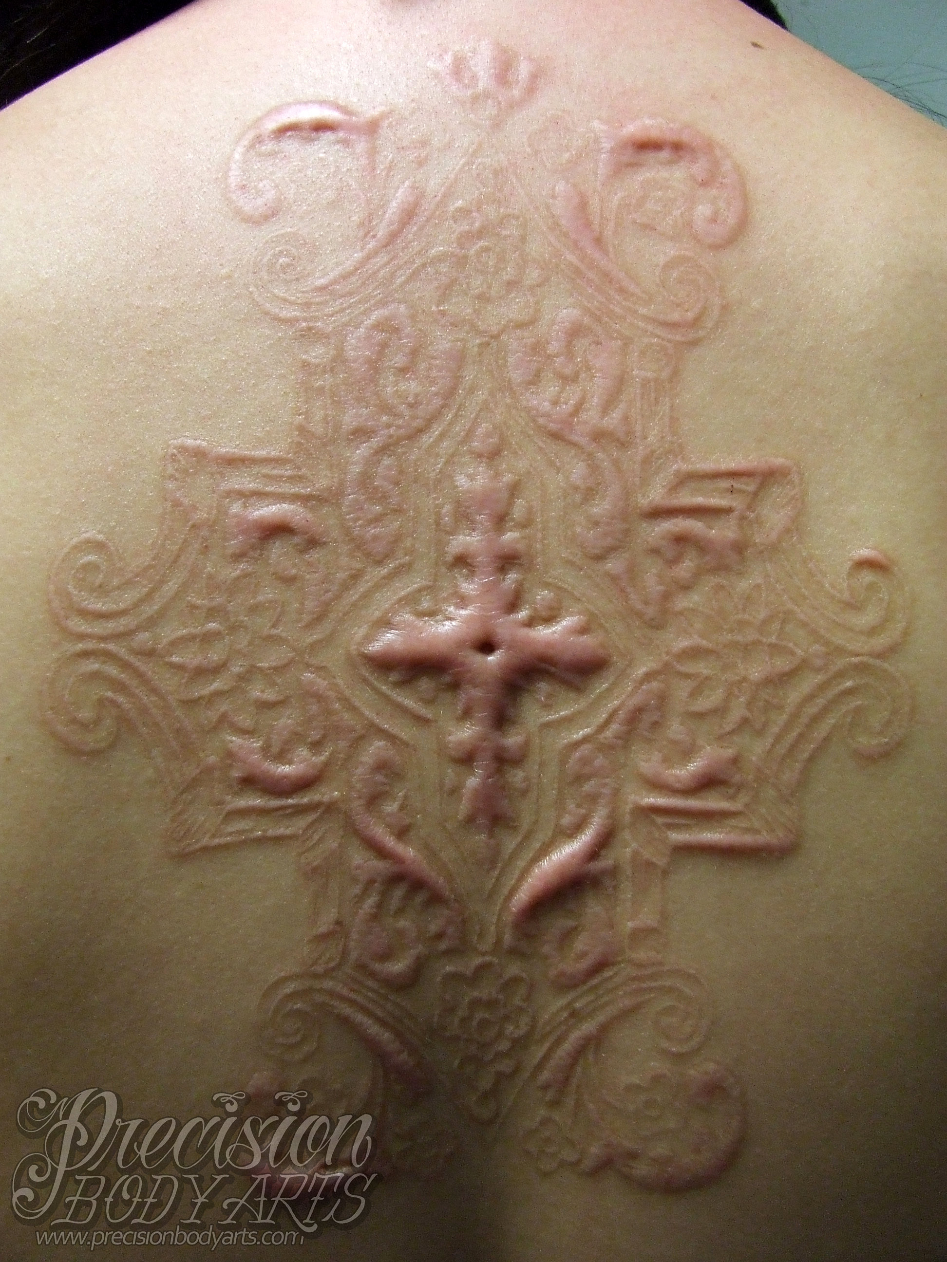 Piercing tattoos scarification and body jewelry in