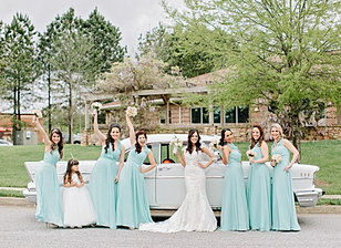 The bridal party posing for pictures