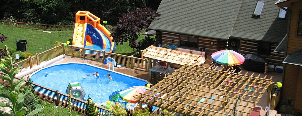 Asheville pool and patio doughboy above ground pools for Above ground pool decks with bar
