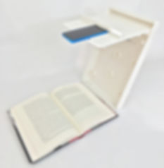 ScanJig stand oriented for book scanning showing a novel being scanned