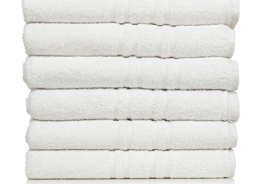 Stack of white plush hotel towels isolated on white background_edited.jpg