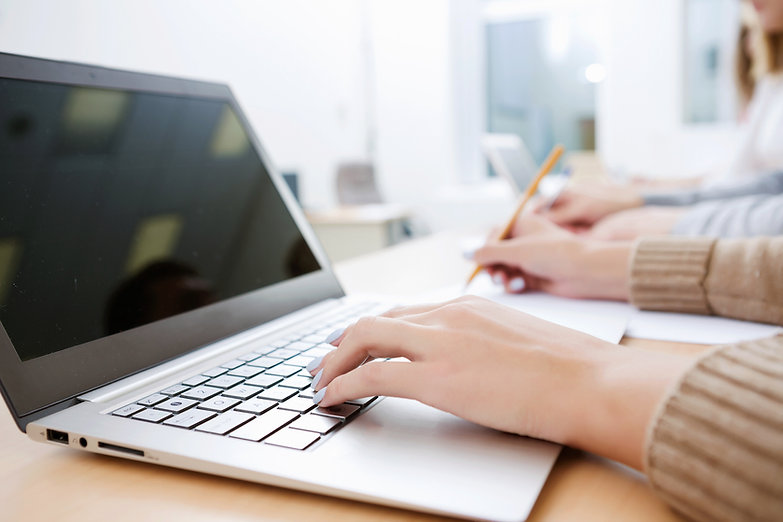 hands typing on laptop keyboard handwriting work search document research write record apply application