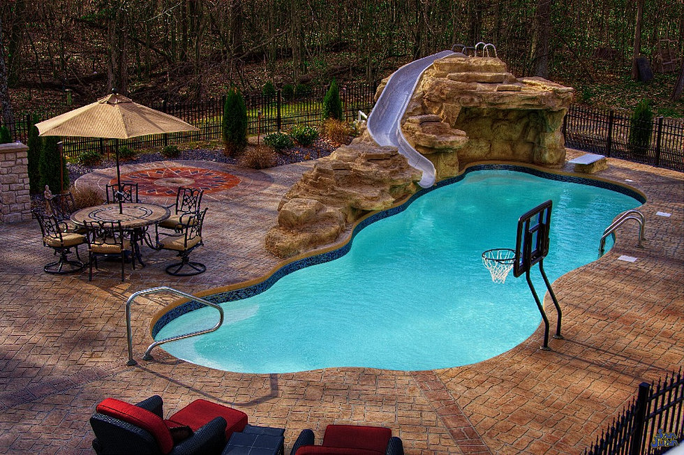 Fiberglass Pool Ideas planting of flowers or bushes in behind your retaining wall can really give your pool that wow factor Backyard Masters Fiberglass Pool