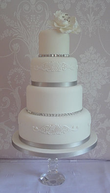 4 TIER WHITE AND DIAMANTE PEONY CAKE