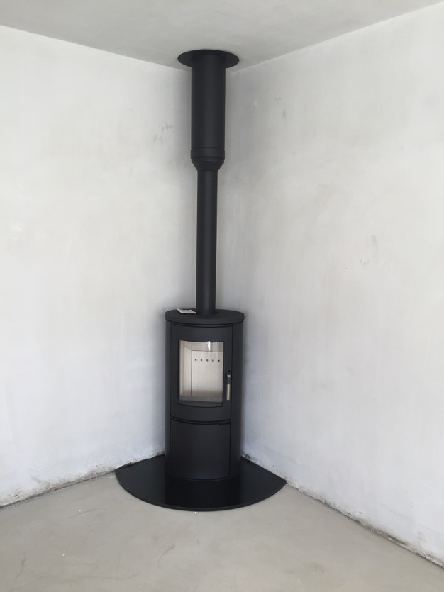 Kratki Kosa Ab wood Burner with Flue pipe installed through the roof - No Chimney No Problem Spratt Fireplaces And Stoves Centre