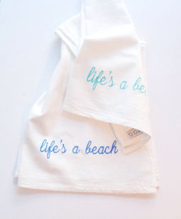 lifes a beach tea towels.jpg