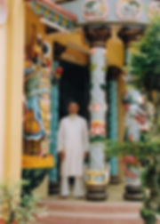 A priest poses outside the Cao Dai temple in Tay Ninh