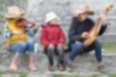 Local children entertain visitors with traditional folk songs