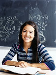 Student in front of chalk board