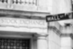 Wall street sign in New York City in bla