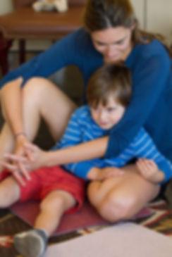 boy in mom's lap