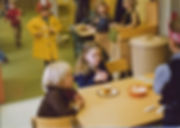 children eating snack and playing