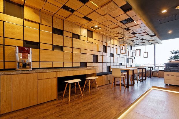 this office building implements black natural sungai wood element combinations on several interior elements such as frames doors ceilings furniture building office pantry