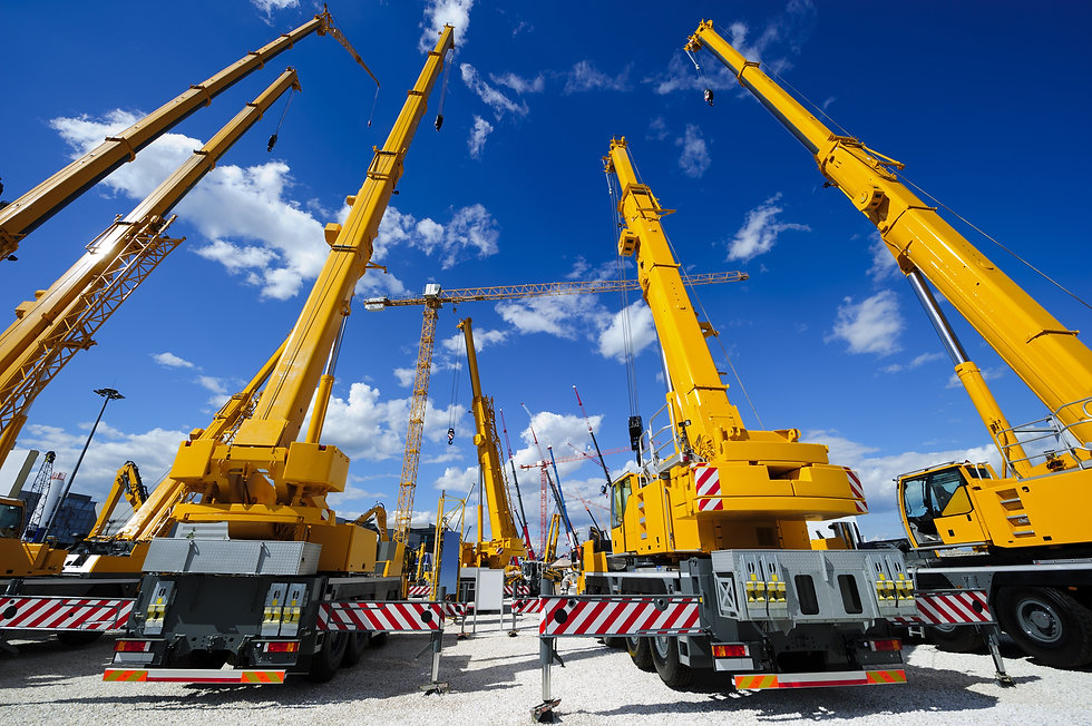 Mobile construction cranes with yellow t