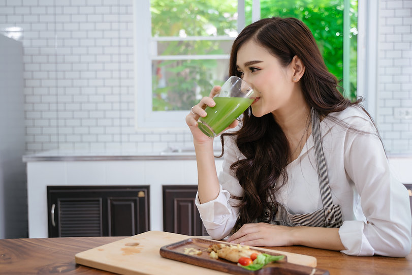 Young asia women drink healthy vegetable
