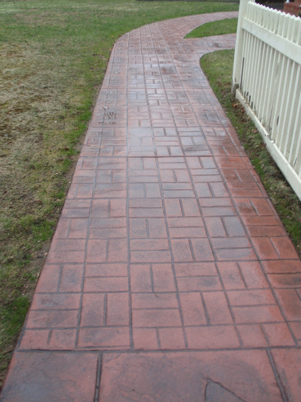 Stamped concrete in new england for Cleaning concrete paths