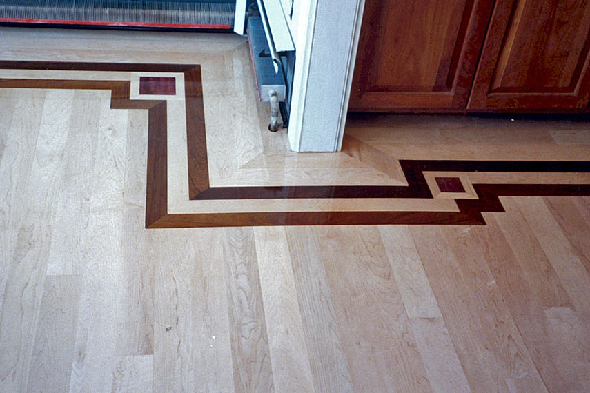 Hardwood flooring feature strip border