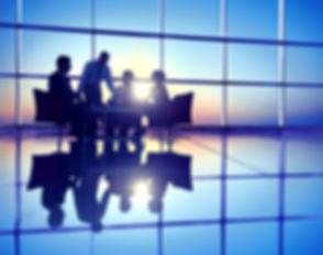 Group of Business People Meeting in Back Lit_edited_edited.jpg