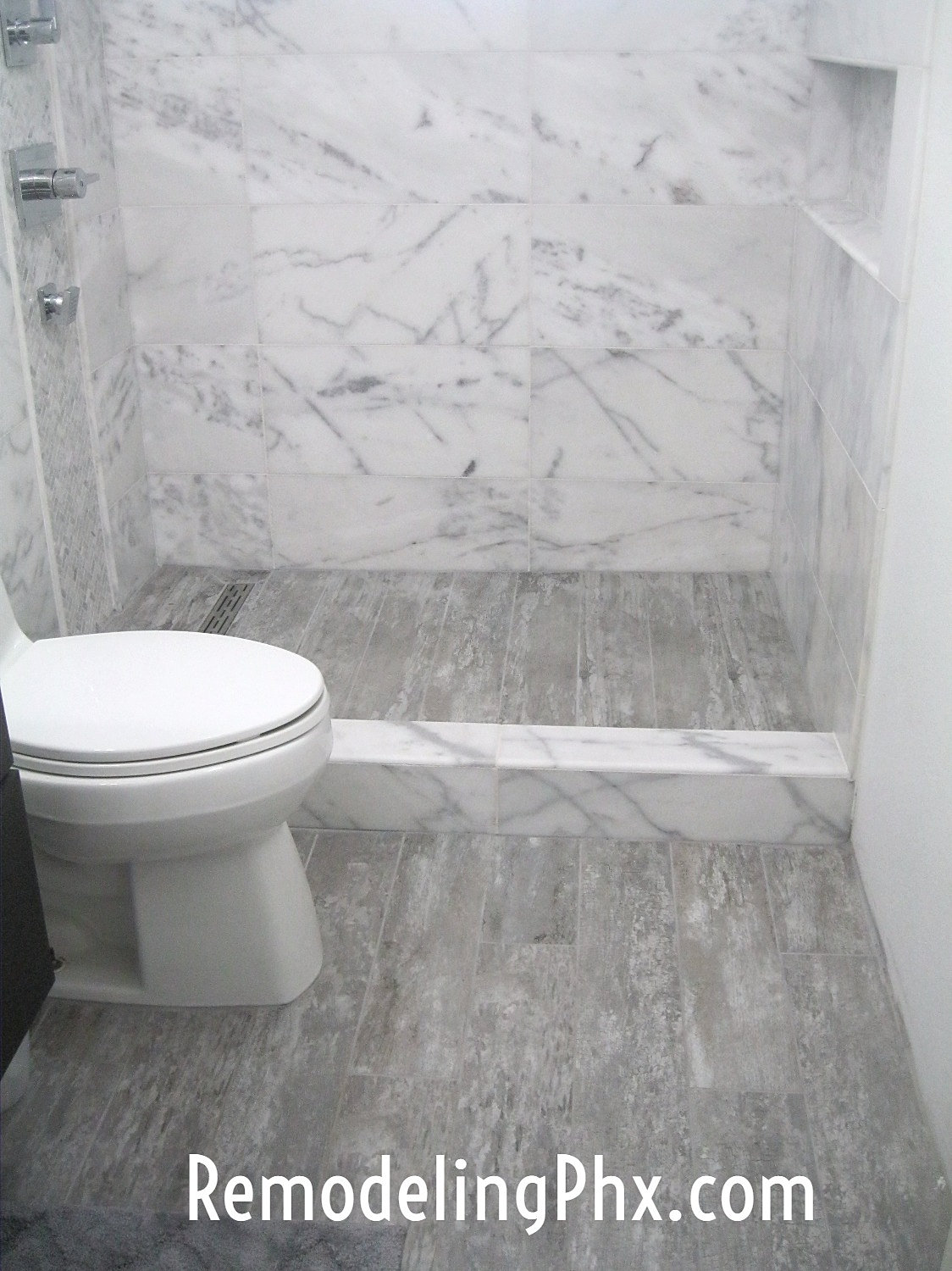 Carrara Marble Shower Remodel. Bathroom and Shower Remodeling Contractor in AZ