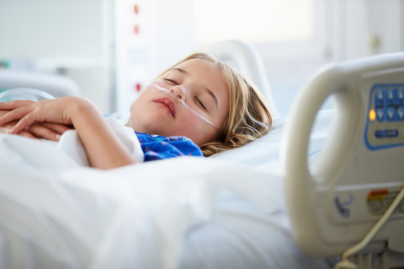 Young Girl Sleeping In Intensive Care Un