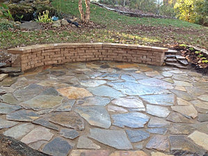 Natural stone patio with seat wall