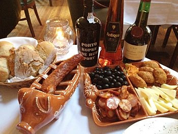 ... sausage, olives, cheeses, cod cakes corn bread and good wine