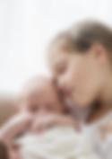 big sister cuddling her newborn baby brother - newborn photographer wiltshire