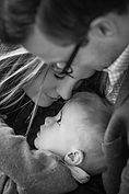 parents holding their baby son - family photographer