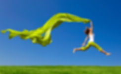 healthy jumping woman blue green.jpg