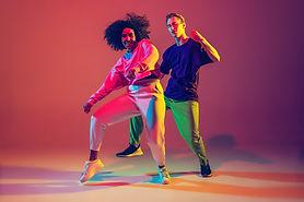 dance-time-stylish-men-woman-dancing-hip-hop-bright-clothes-green-background-dance-hall-ne
