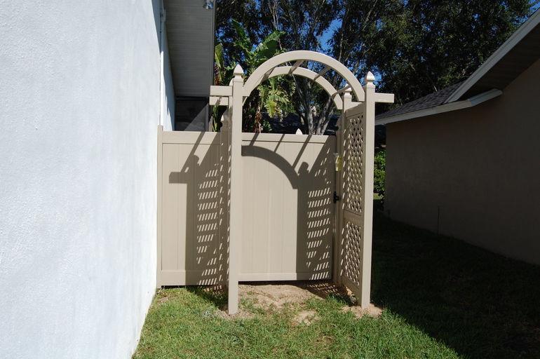 adobe fence arbor