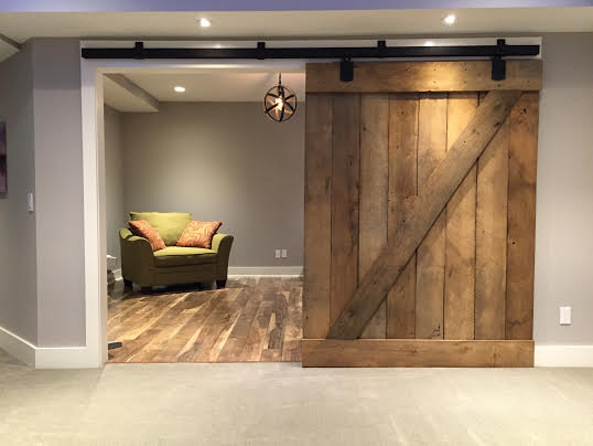 Reclaimed sliding barn doors and cost midwestern barns llc for Oversized interior barn doors