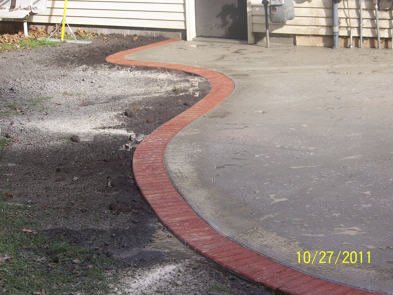 This Patio Is A Broom Finished Concrete With A Stamped Brick Border.