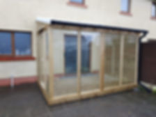 Wooden conservatory - handmade conservatry custom lean to - glass extension at back of house