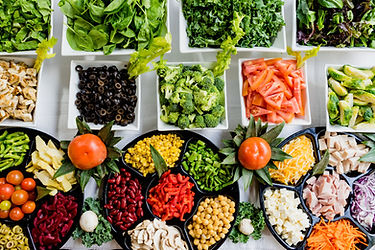 Image by Dan Gold buffet food eat meal dinner lunch vegetables event catering cater salad lettuce kale black olives tomatoes red papper broccoli stalks mushrooms chickpeas garbanzo beans shredded cheddar cheese crumbled feta green pepper cherry tomatoes kidney beans salad bar