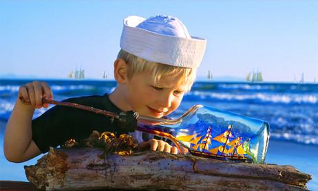 dorit-lombroso-boy-with-boat-in-bottle