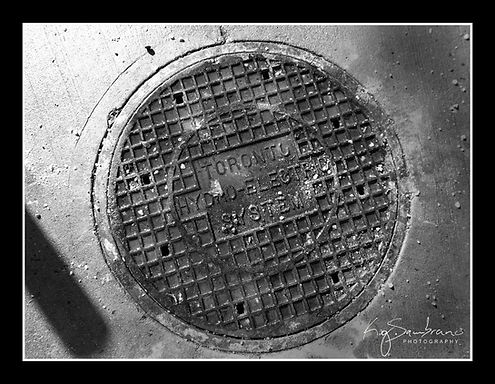 city street, sewer cover