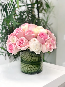 blush roses with ranunculus and peonies.