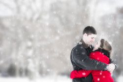 Winter engagement photo with snow