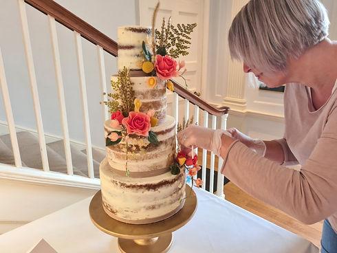 setting up wedding cake Cheeky Cake Company in Plymouth.jpg