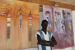 Ibrahima Diokhané, dit Ibou devant ses toiles