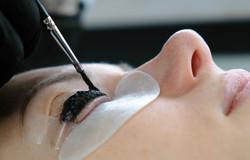 Beauty treatment. Cosmetologist puts bla