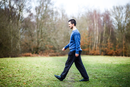 Picture of someone walking in a park